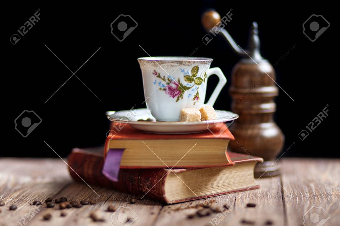 Vintage coffee cup and books on a wooden table stock photo vintage coffee cup and books on a wooden table stock photo 29283705 geotapseo Gallery