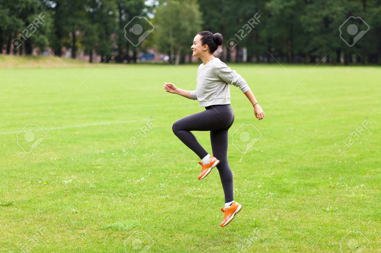 Young woman working out in a park - 30454136