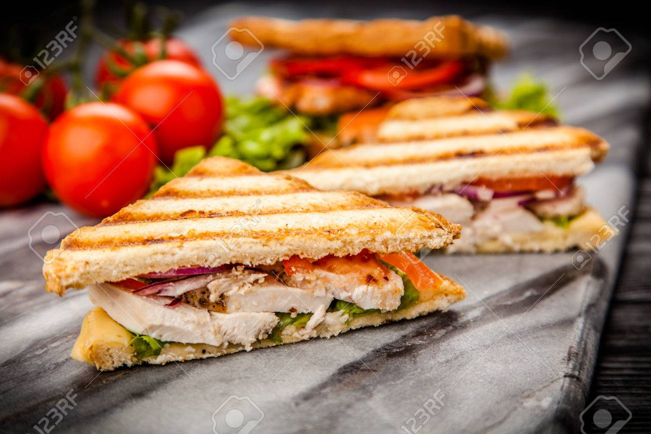 Grilled Chicken Sandwich With Yellow Cheese And Vegetables Stock Photo Picture And Royalty Free Image Image 58394891
