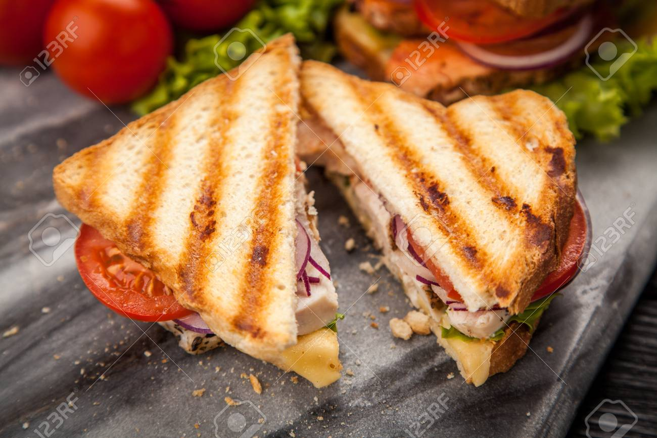 Grilled Chicken Sandwich With Yellow Cheese And Vegetables Stock Photo Picture And Royalty Free Image Image 58885789