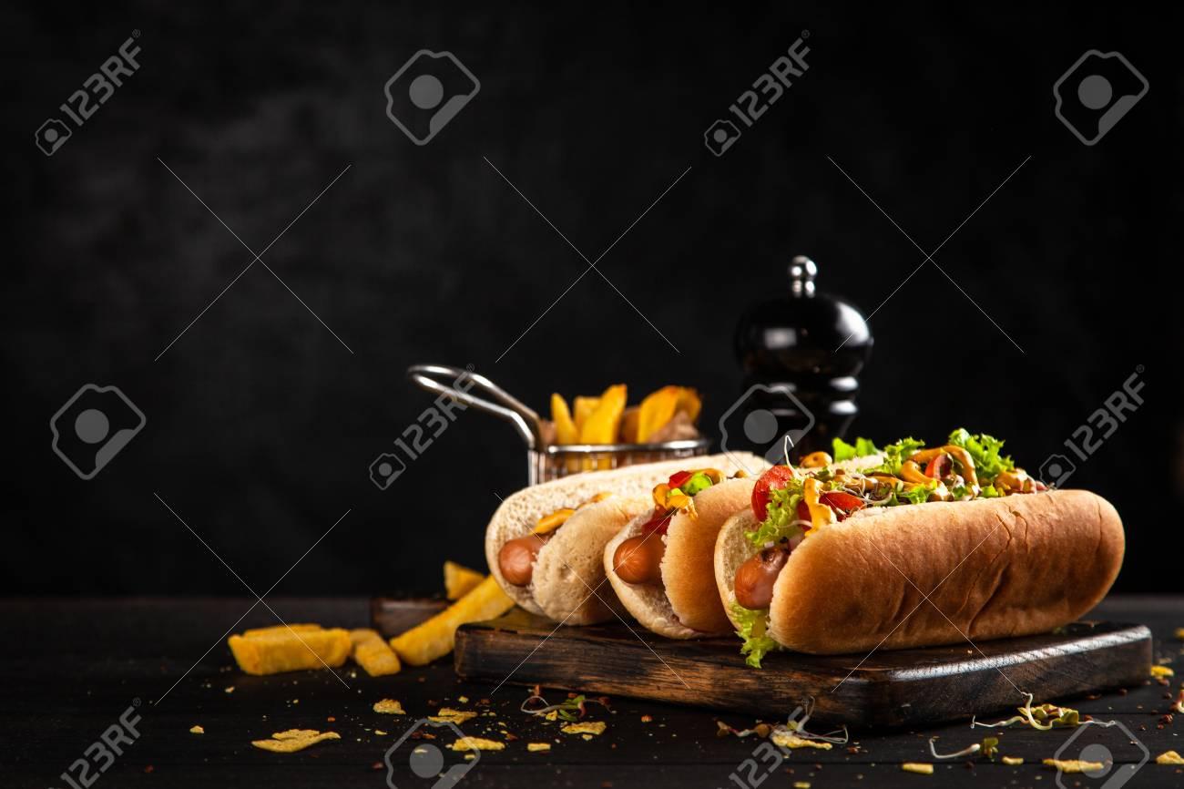 Three delicious hotdogs - 122029913