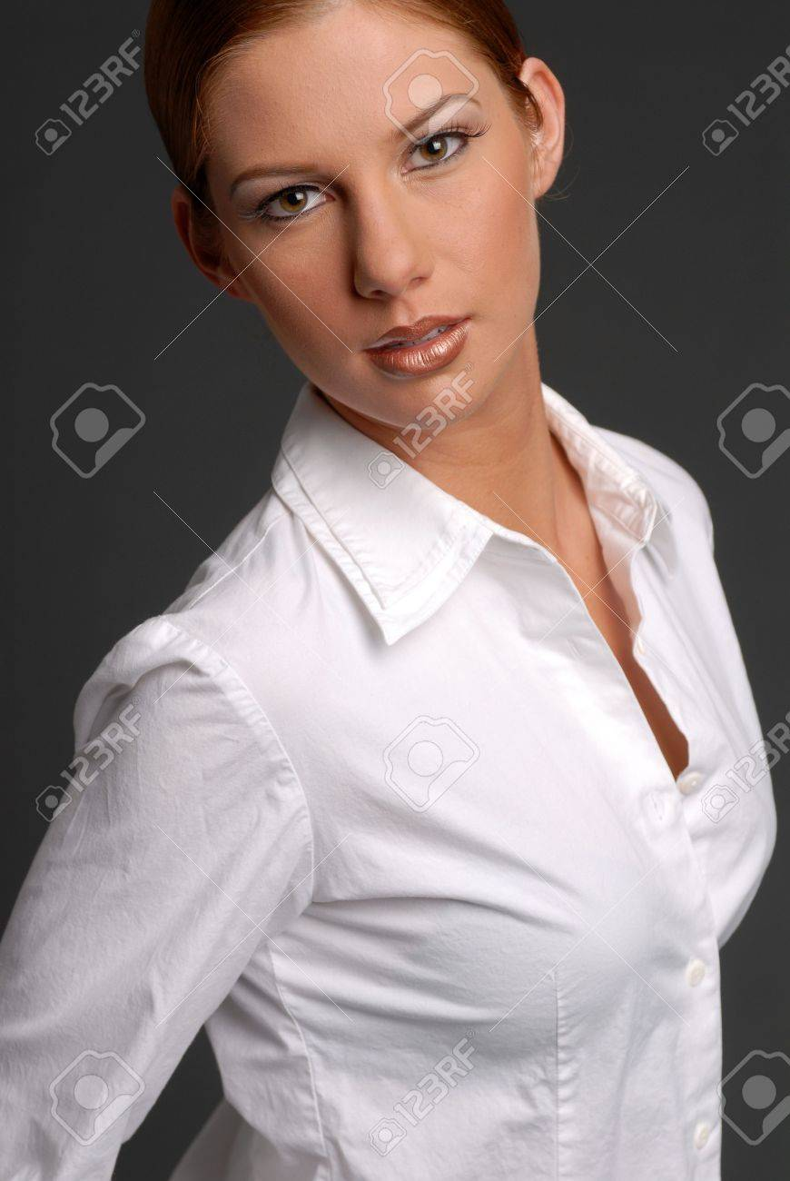 Beautiful Woman In White Shirt With Hair Pulled Back Stock Photo ...