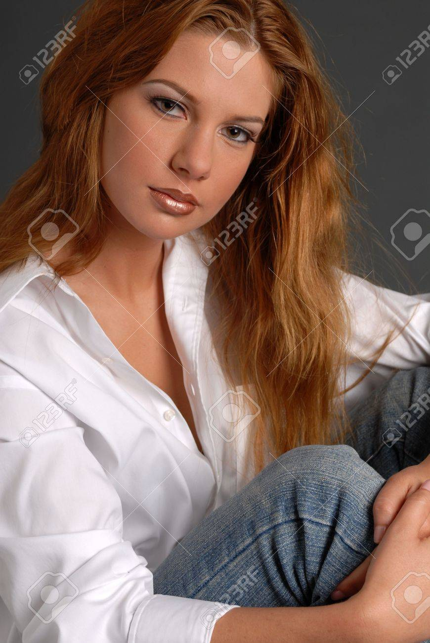 Beautiful Woman With Long Red Hair In White Shirt And Jeans ...