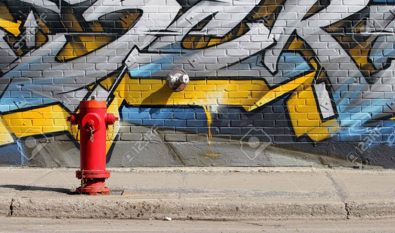 image of a red fire hydrant in front of a graffiti wall Stock Photo - 12904217