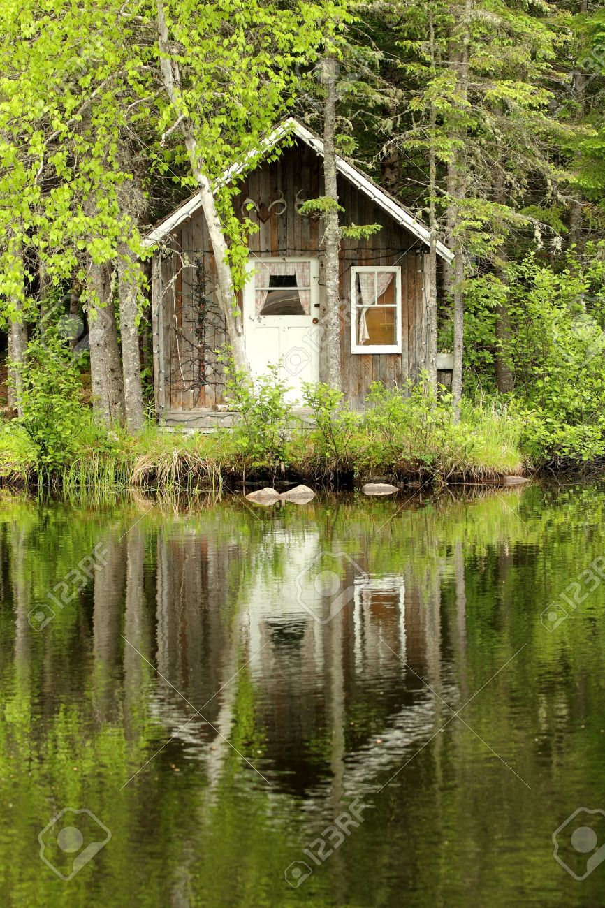 Little Wood House Making A Reflection On A Calm Lake Stock Photo   14009240