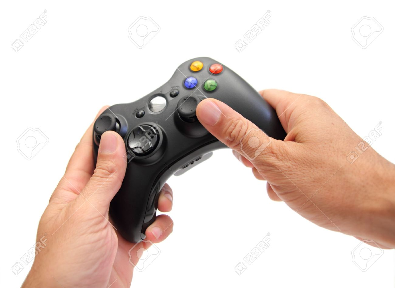 closeup of two hands holding a videogame controller Stock Photo - 14604710