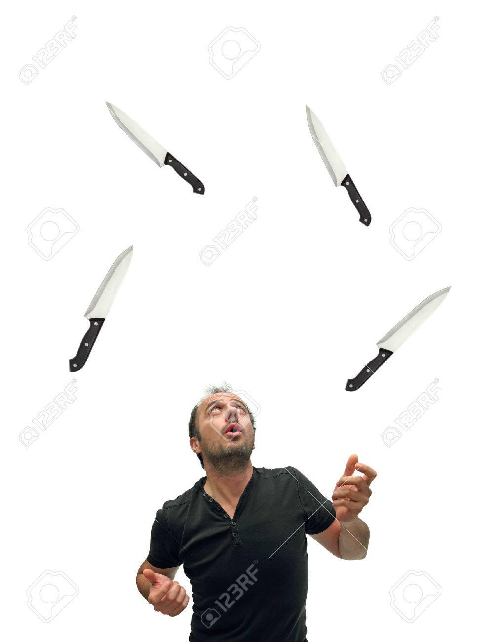 juggler using knives over white Stock Photo - 18333295