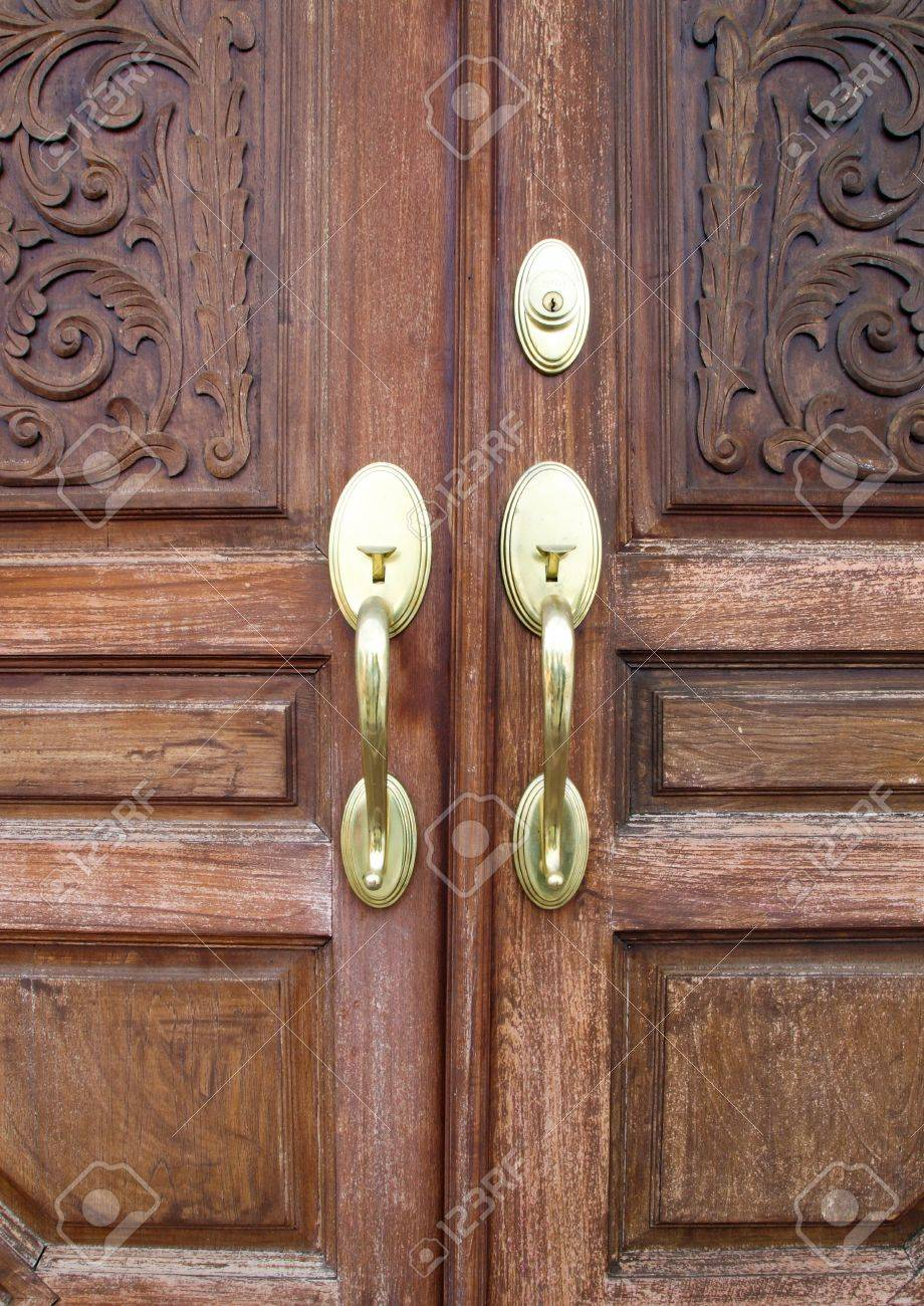 Front Double Door Hardware - Door handles with an old double door stock photo picture and