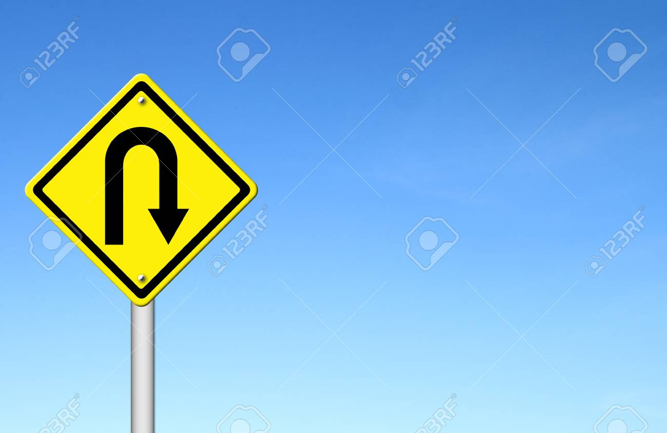 Yellow warning sign u-turn roadsign with blue sky background blank for text Stock Photo - 15467854