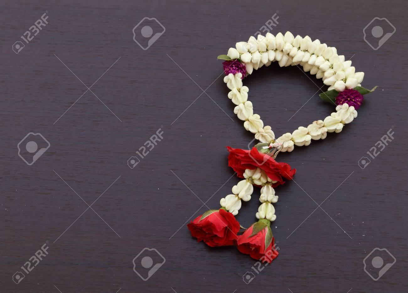 Garland Of Jasmine Flower On Wood Background Blank For Text Stock