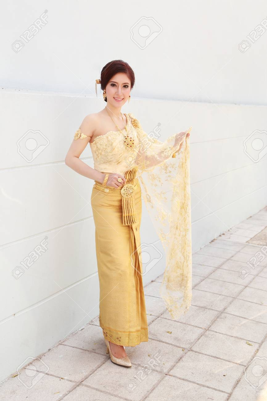 woman with Thai dress and wall background - 39191471