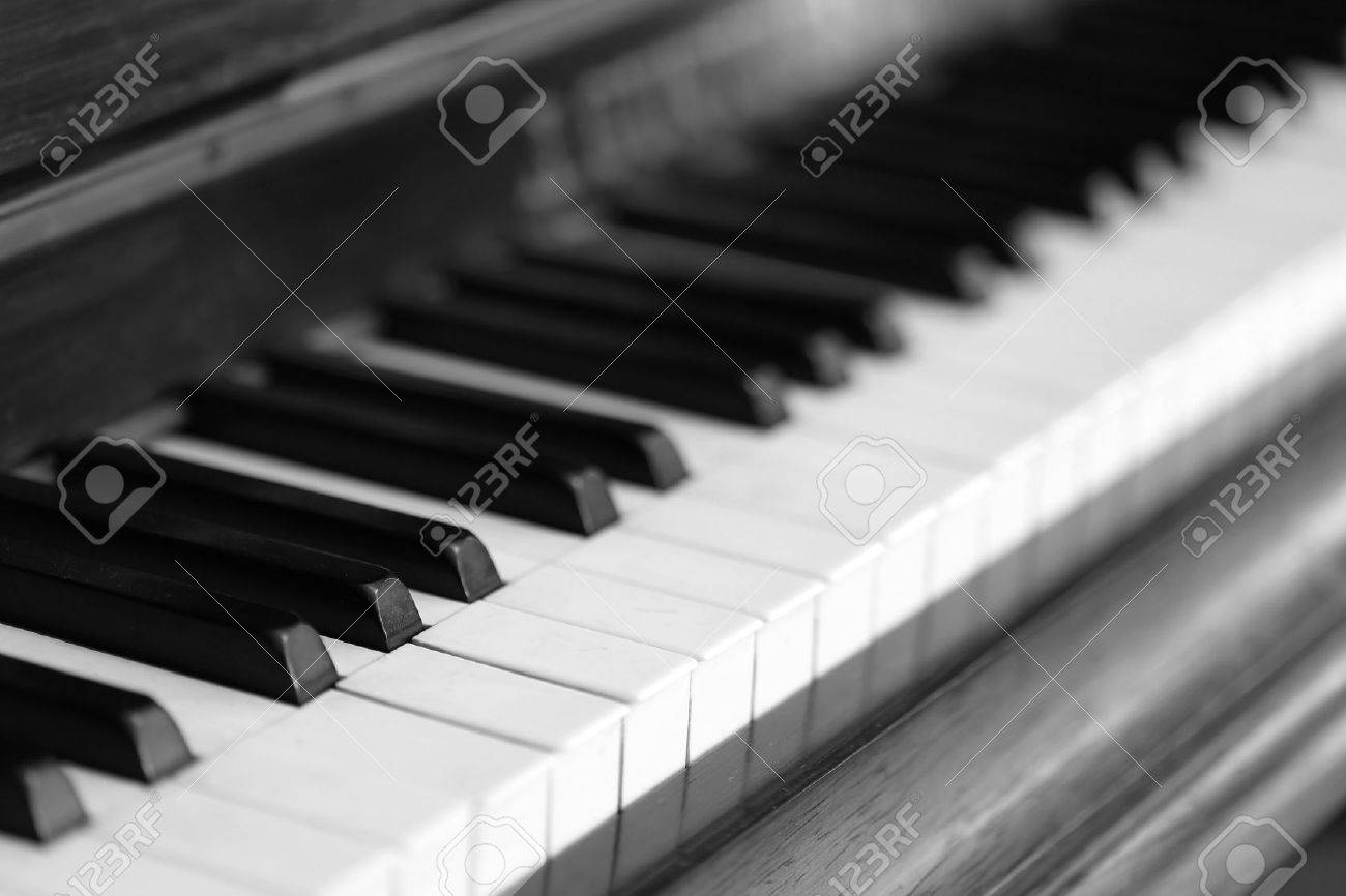 black and white piano keys and wood grain (soft focus) - 41916325