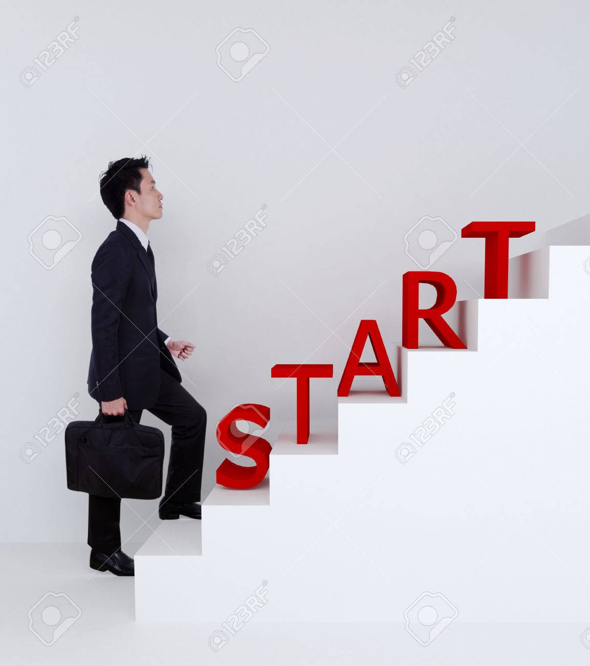 business man start stepping up on stairs to success of bussiness