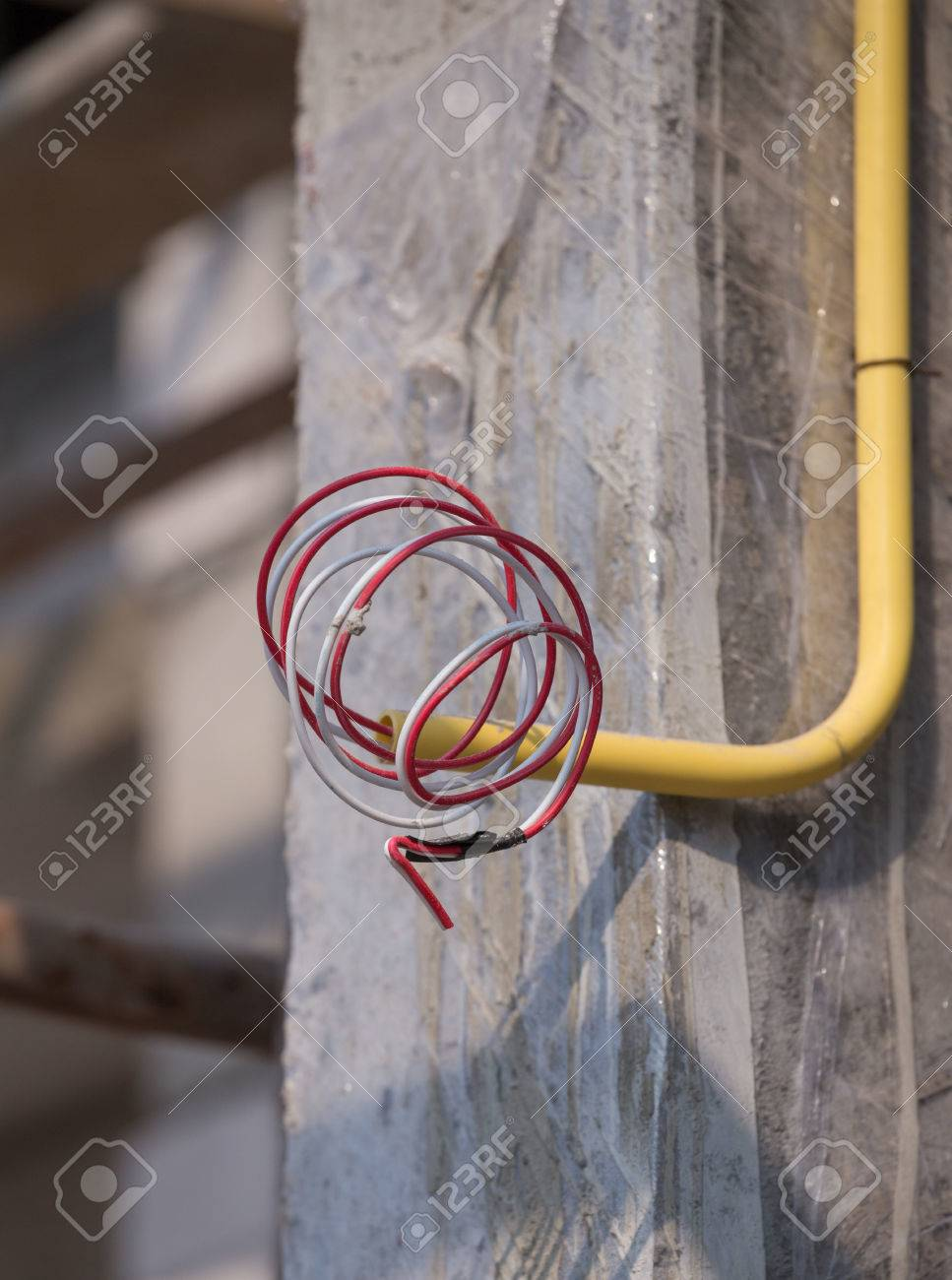 Yellow PVC Pipes For Electrical Boxes And Wires Buried On Concrete ...