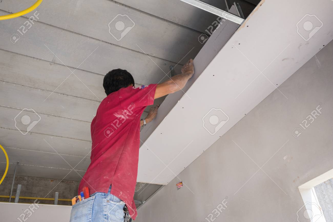 Nice Stock Photo   Unidentified Worker Installing Gypsum Board Ceiling Of  Building House Construction