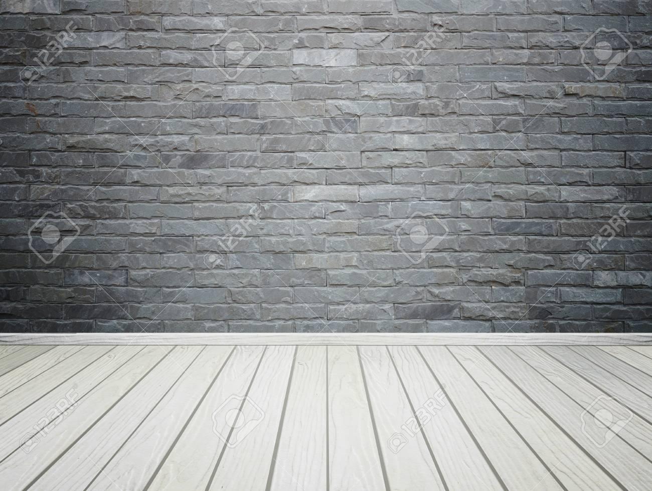 Interno stanza vuota con mattoni in pietra piastrelle a parete e
