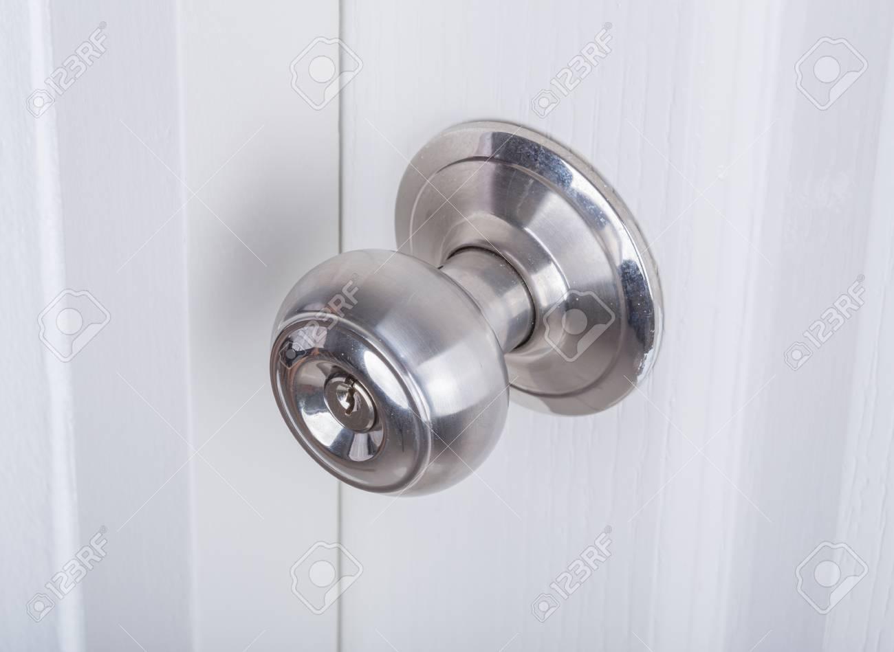 Aluminum Door Knob On The White Door Stock Photo   75064078
