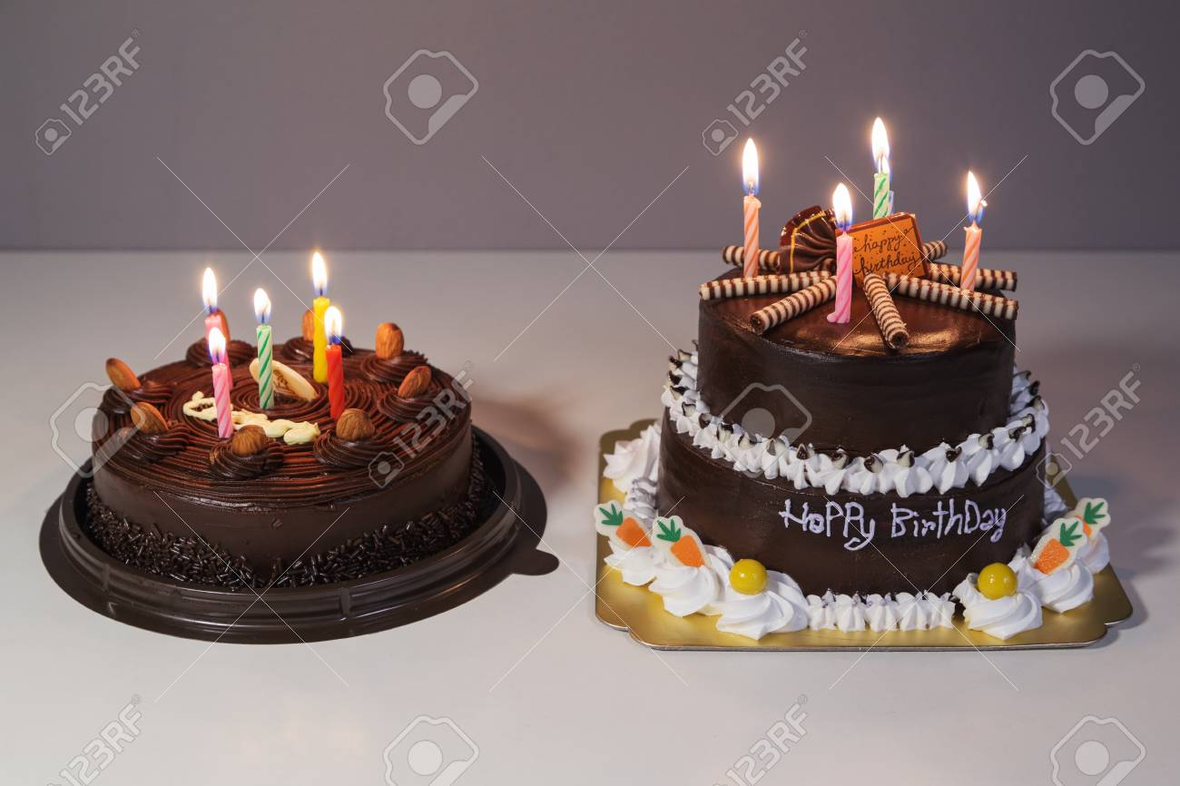 Two Chocolate Cake With Happy Birthday Light Candle Stock Photo