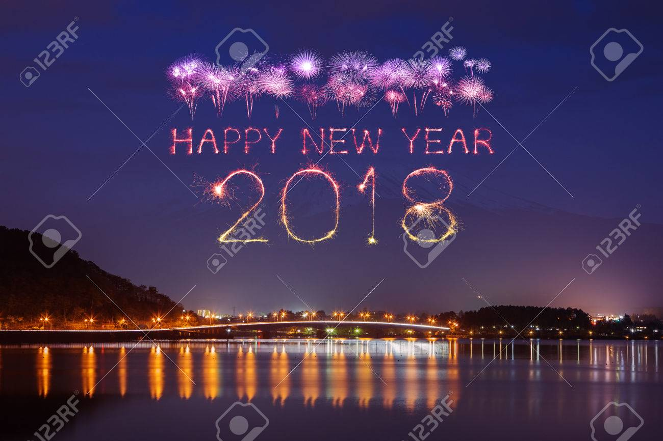 2018 happy new year firework sparkle with fujisan mountain background at night japan stock photo