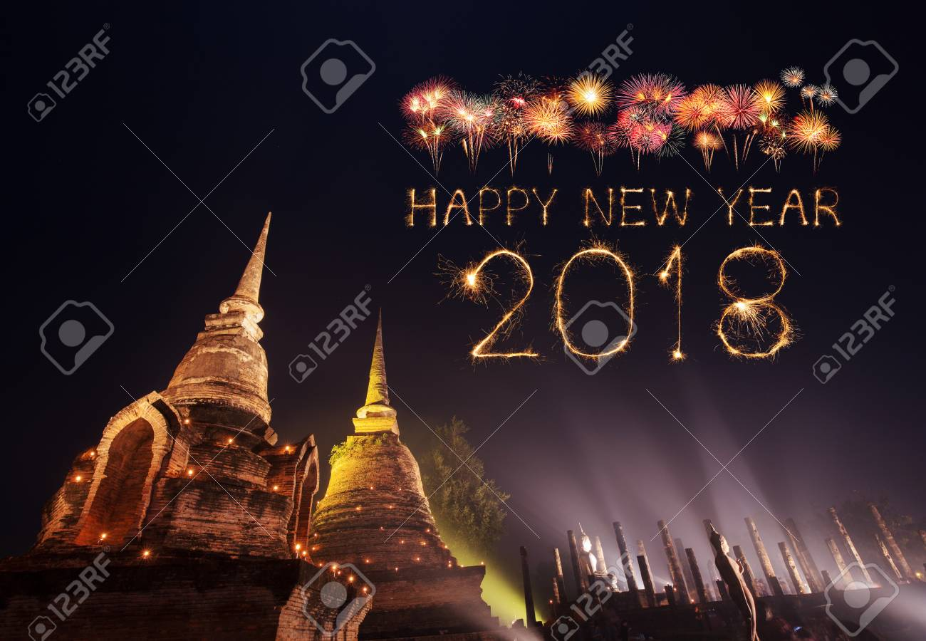 2018 happy new year firework sparkle with sukhothai historical park at night thailand stock photo