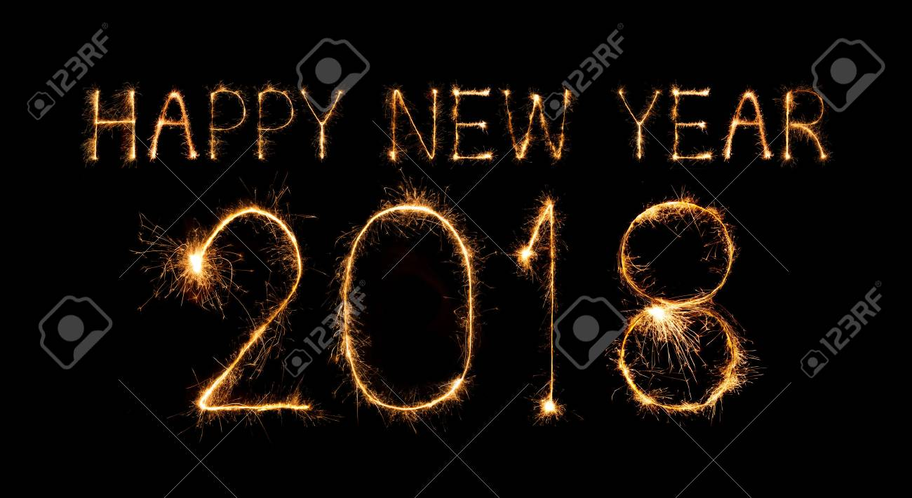 happy new year 2018 written with sparkle firework at night stock photo 87323731