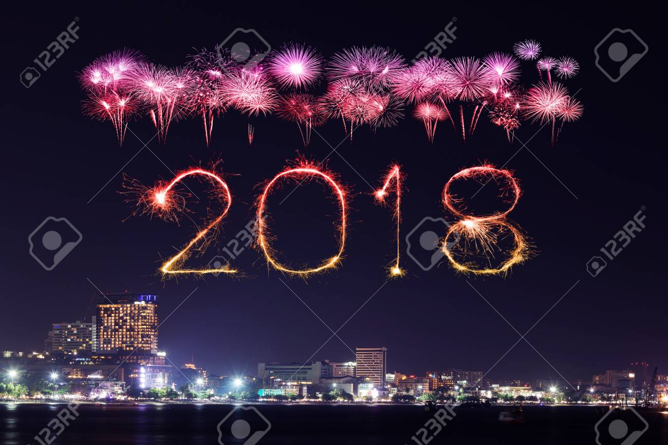 2018 happy new year firework sparkle with pattaya cityscape at night thailand stock photo