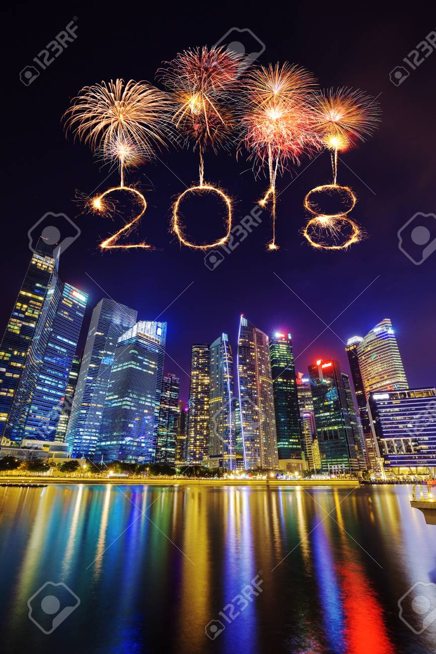 2018 happy new year firework sparkle with central business district building of singapore city at night