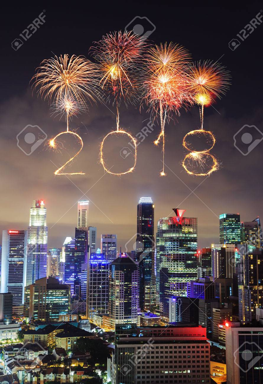 2018 happy new year firework sparkle with cityscape view of singapore city at night stock photo