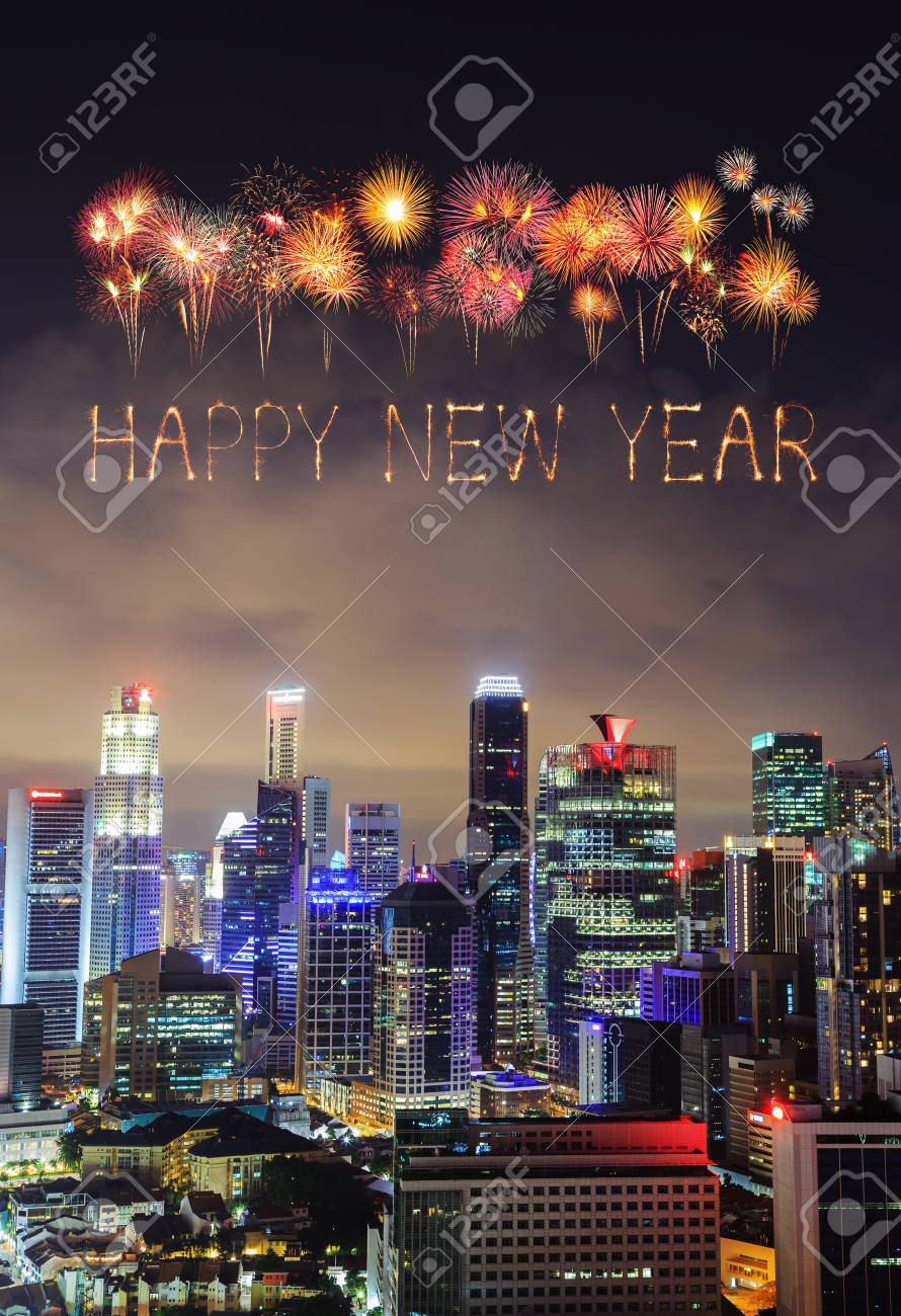 happy new year firework sparkle with cityscape view of singapore city at night stock photo