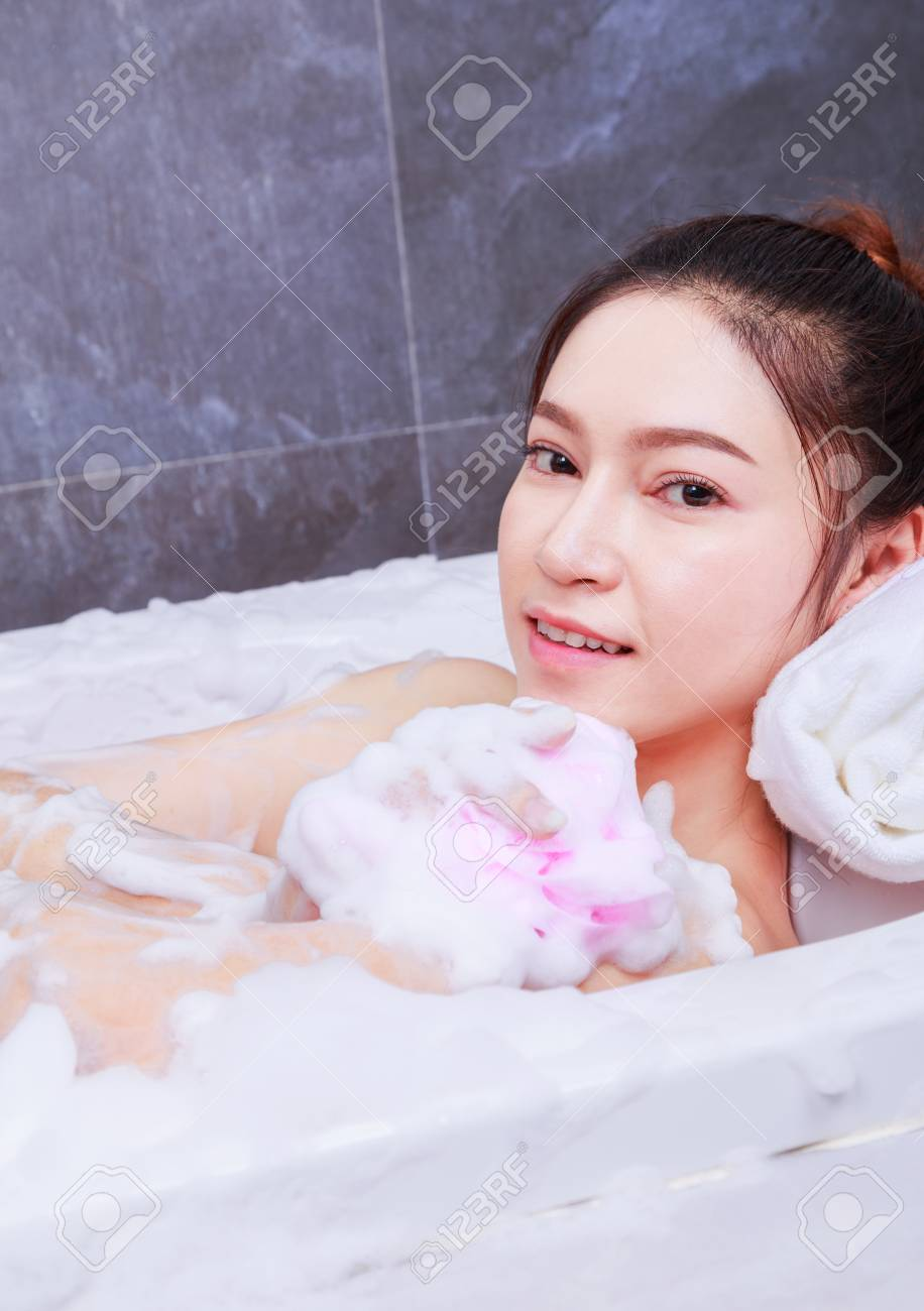 Pretty Woman Relaxing In The Bathtub Bathroom Stock Photo