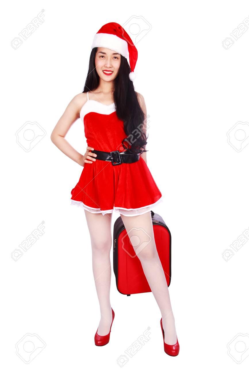 nuovi arrivi vendita ufficiale prezzo competitivo Donna felice in vestiti del Babbo Natale con la valigia isolata su una  priorità bassa bianca
