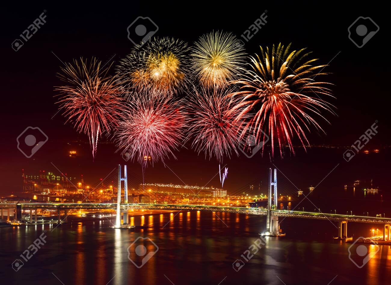 Fireworks celebrating over Yokohama Bay Bridge at night, Japan - 131648006