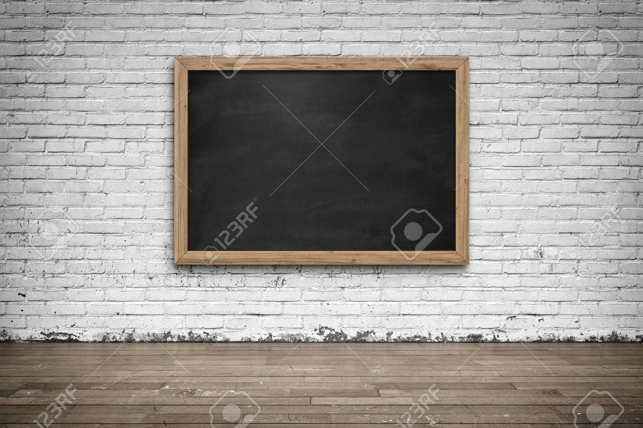 Blank Black Chalkboard In Wooden Frame On Brick Wall With Wooden ...