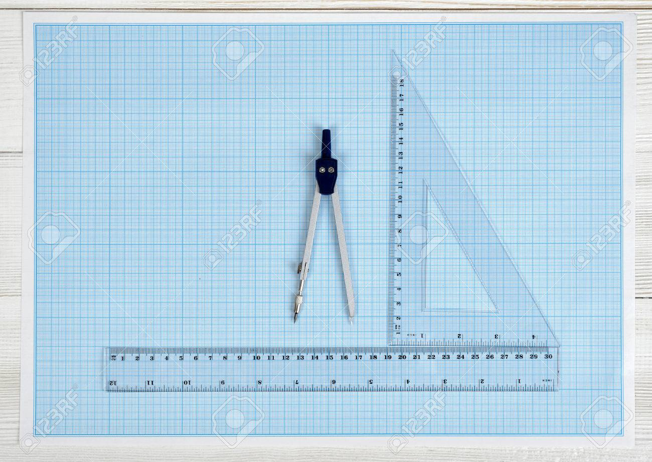 Triangle centimeter ruler simple centimeter ruler and engineering triangle centimeter ruler simple centimeter ruler and engineering divider on a blueprint top view composition measuring process work place of draftsman malvernweather Gallery