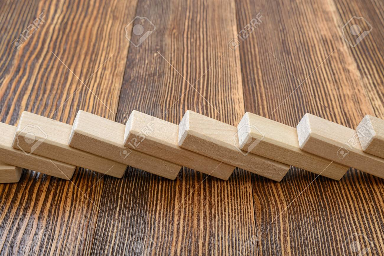 Close-up of wooden bricks lay in a row  Game of physical and