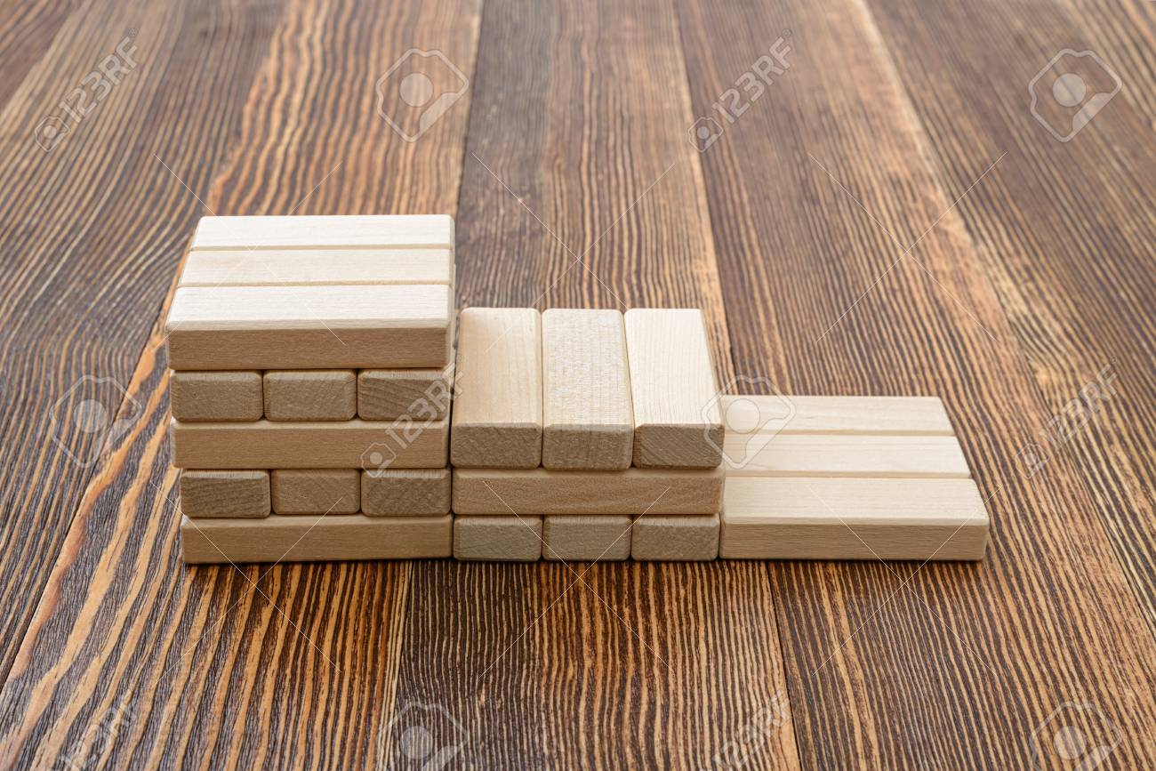 Close-up wooden bricks in the form of steps  Game of physical