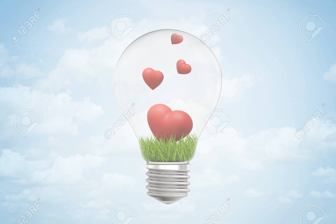 3d closeup rendering of lightbulb and green grass and four cute red hearts inside it, against blue sky with clouds. - 124050929