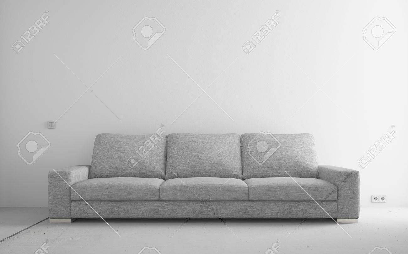 Gray modern sofa in empty room with white walls and concrete..