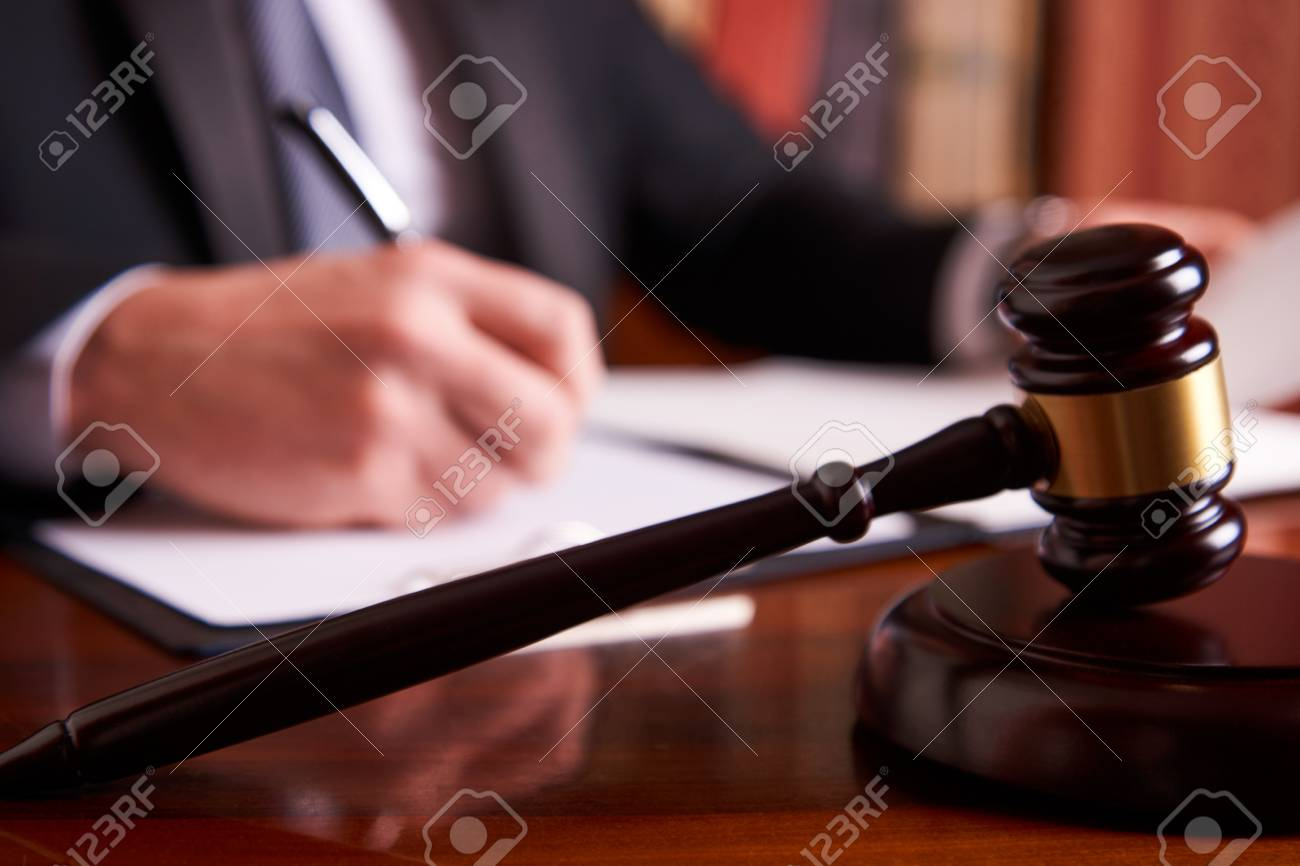 Judge's gavel on wooden table and Attorney working in courtroom. Court justice legal legislation concept - 91387619