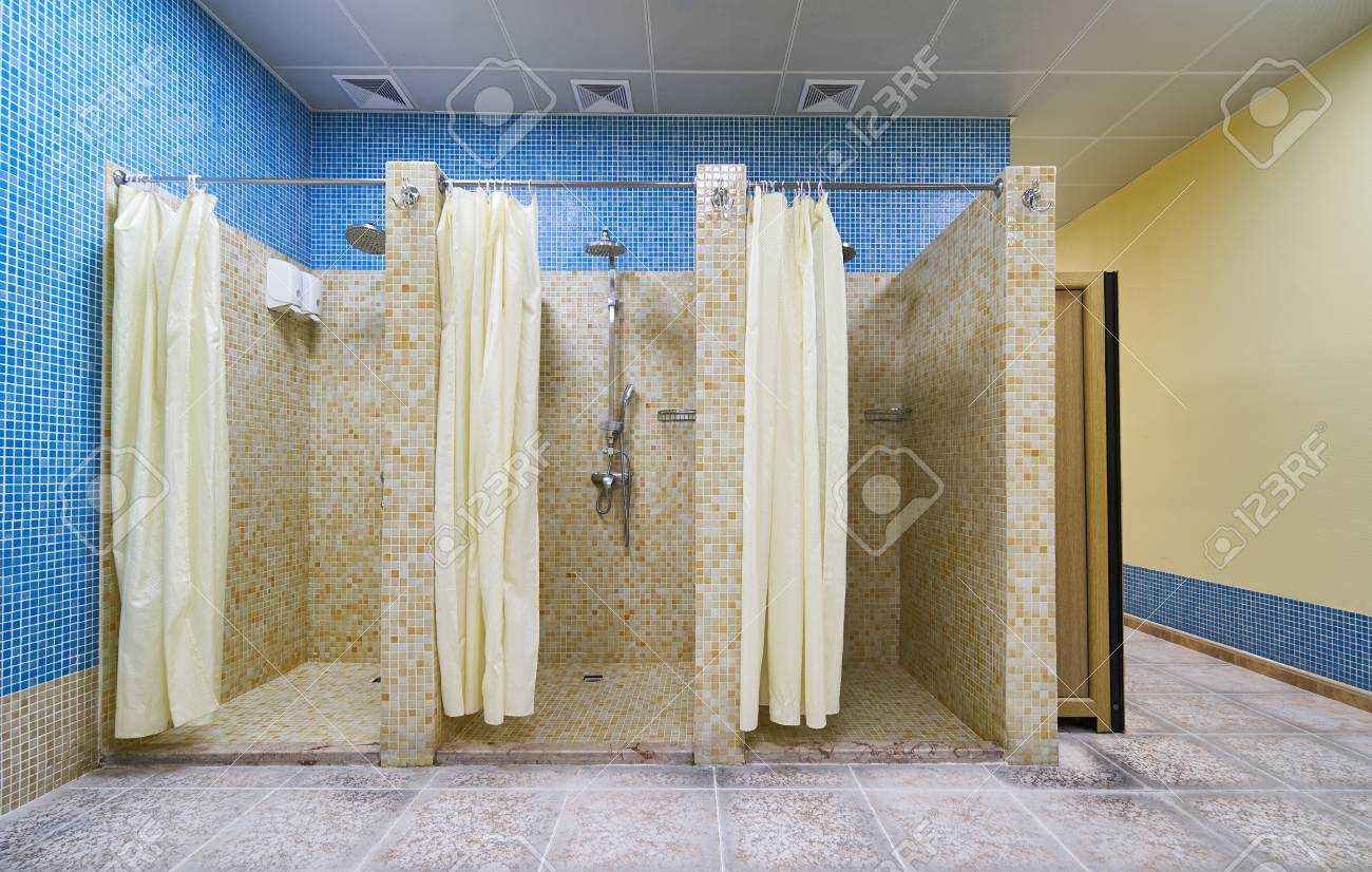 Three empty showers in modern gym locker room stock photo picture