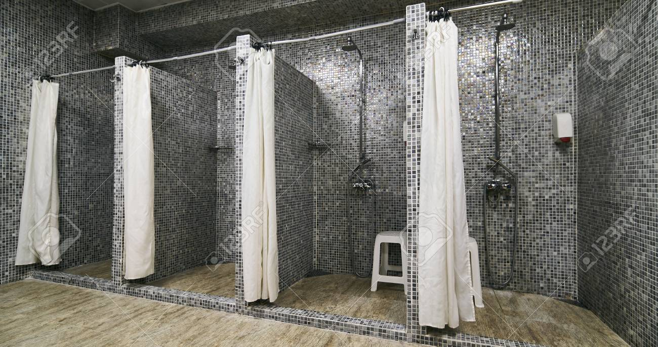 Empty showers in modern gym locker room stock photo picture and