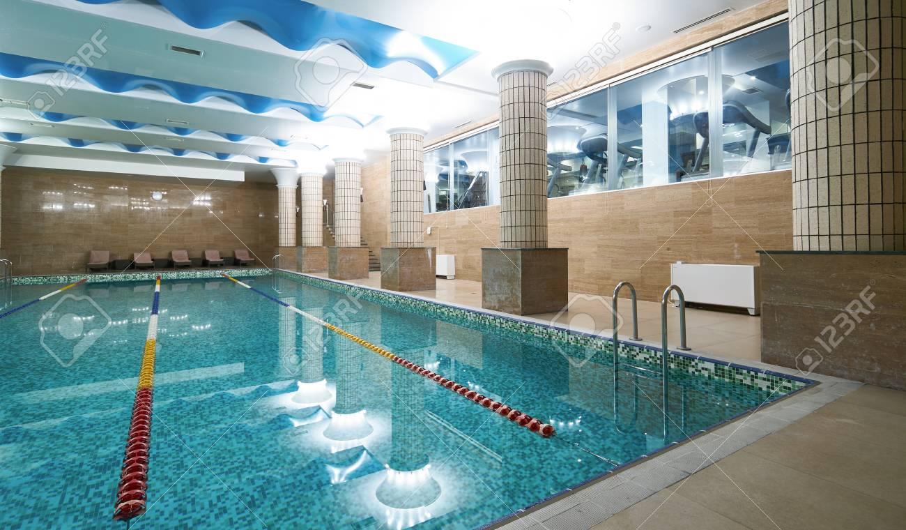 indoor gym pool. Indoor Public Swimming Pool Interior In Fitness Gym Club. Healthy Concept Stock Photo - 98008945