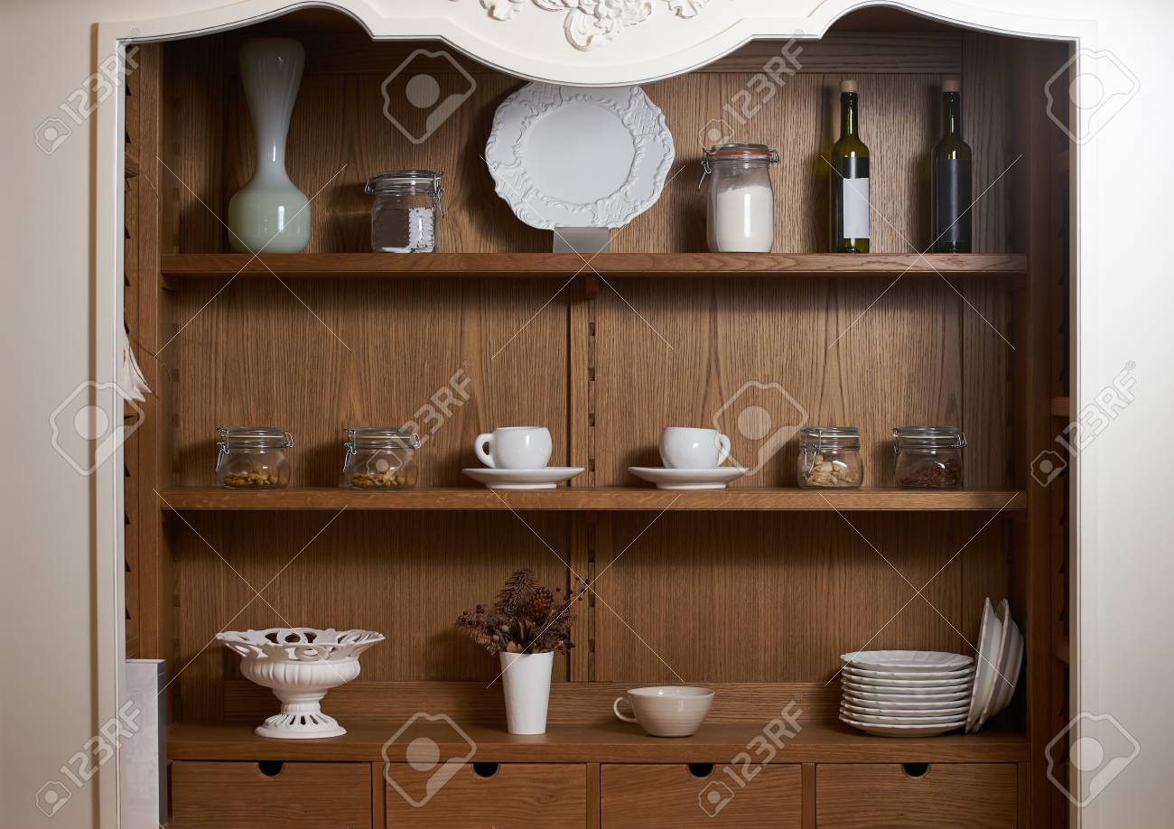 Kitchen cupboard with nice rustic dinnerware. Wooden kitchen..