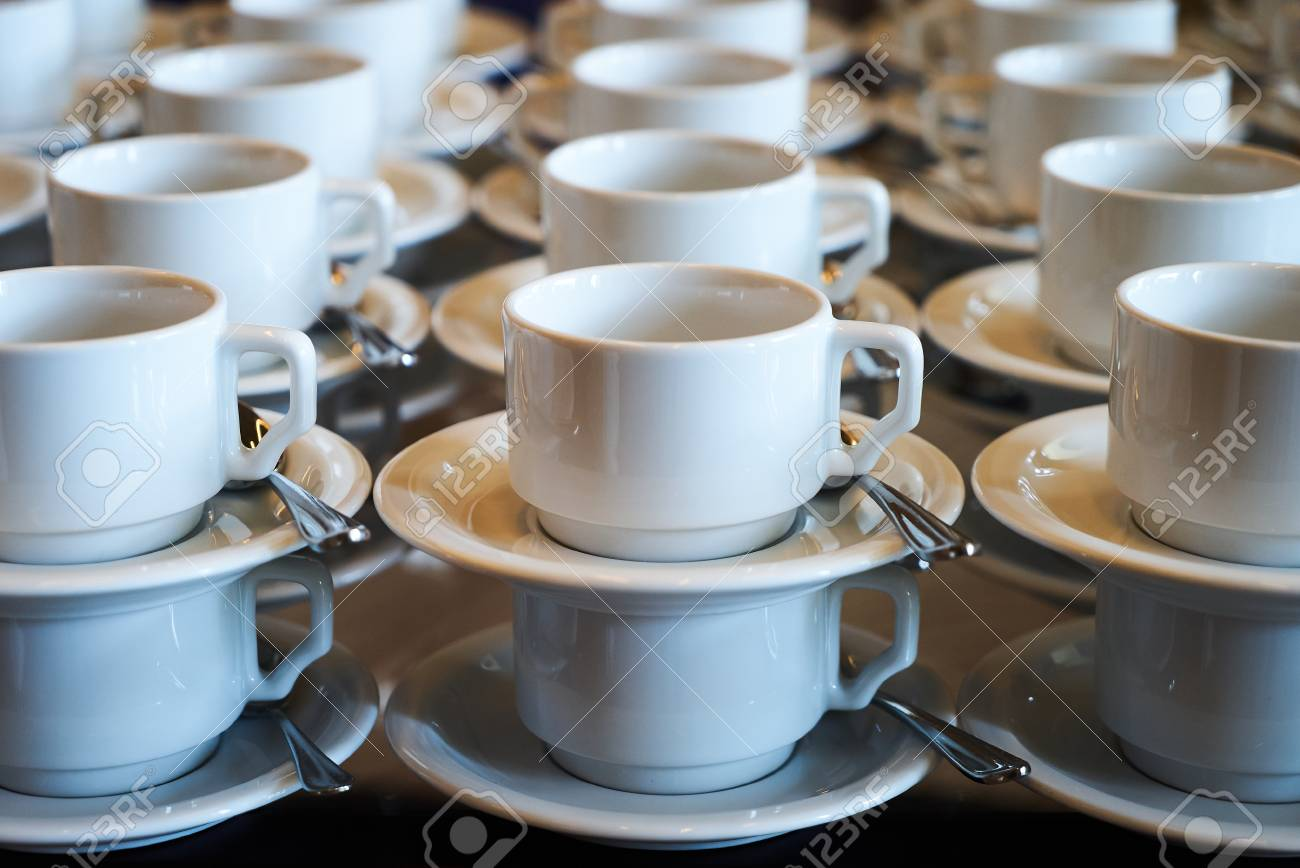 Set Of Empty White Ceramic Tea Or Coffee Cup And Saucers Group Stock Photo Picture And Royalty Free Image Image 99652796