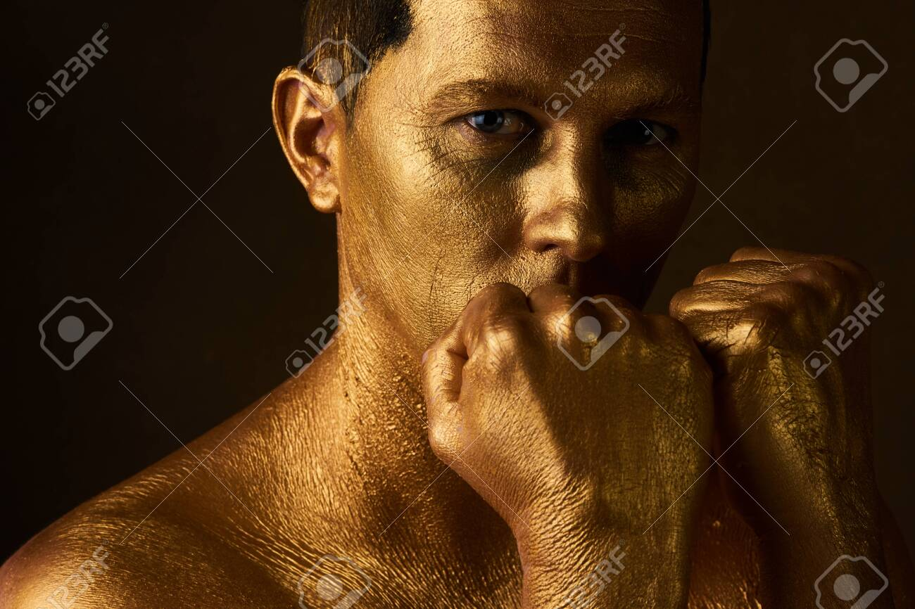Body Art Paint With Gold On Face Of Man Over Dark Background Stock Photo Picture And Royalty Free Image Image 113839033