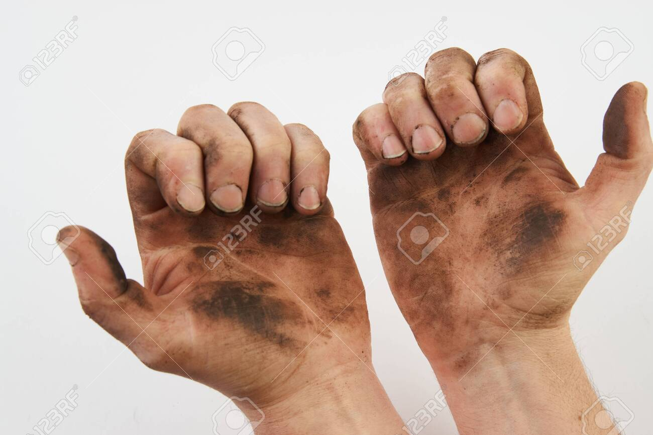 Dirty hand isolated on a white background with copy space. Man show his dirty hands with palms, close-up - 143962882