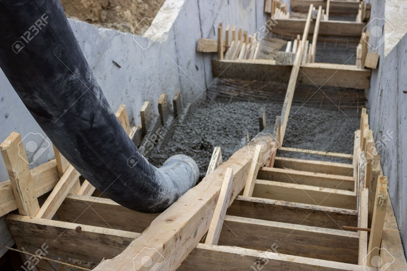 Pouring Concrete Steps With Tube From Truck Mounted Concrete Pump Stock  Photo   24032088