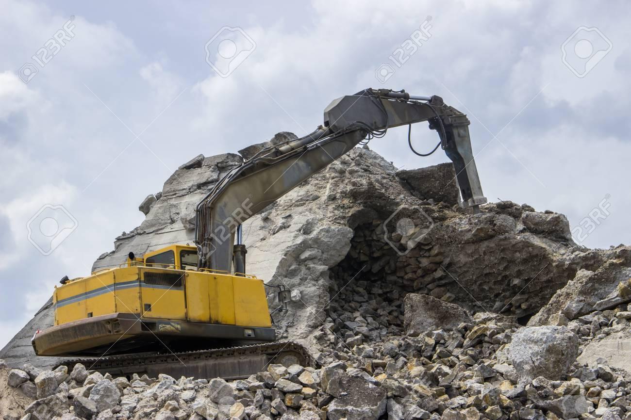 Excavator with hydraulic breaker or jackhammer crashing reinforced
