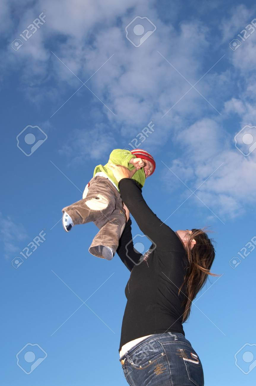 The mother lifts the son to the sky Stock Photo - 1533779
