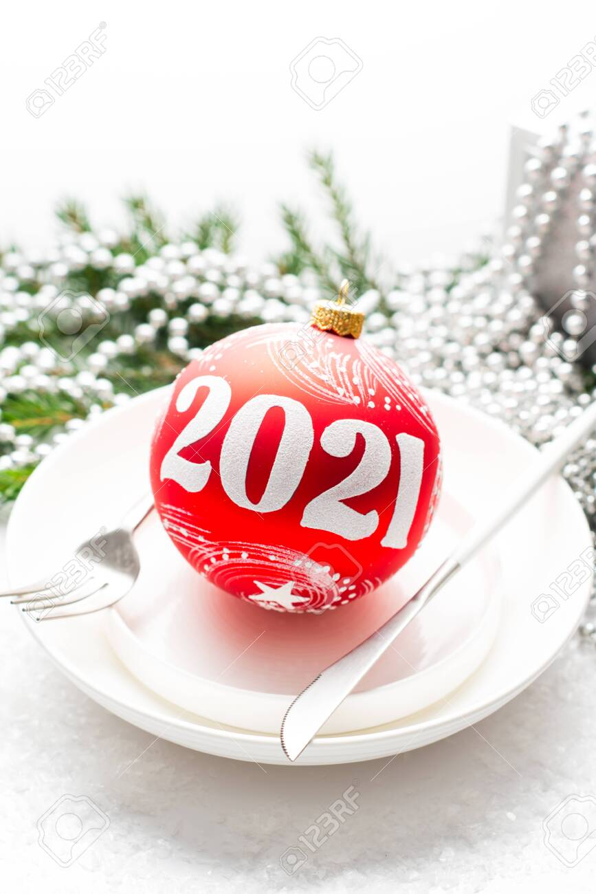 2021 Christmas White Background Christmas Composition With A Gift Red Christmas Ball On A White Stock Photo Picture And Royalty Free Image Image 156796406